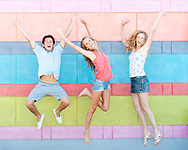Young people jumping with bright colours