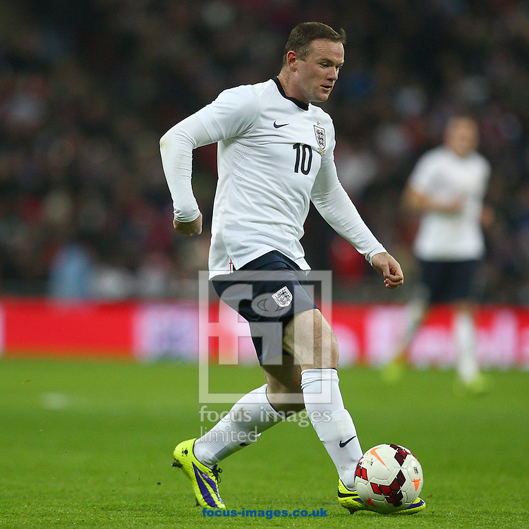 Picture by Rob Fisher/Focus Images Ltd +44 7450 945824<br /> 15/11/2013<br /> Wayne Rooney of England on the ball during the Friendly match at Wembley Stadium, London.