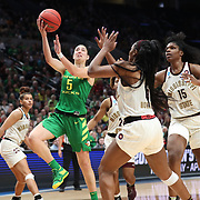 March 31, 2019; Portland, OR, USA;  Oregon Ducks guard Maite Cazorla (5) shoots over Mississippi State Bulldogs in the Elite Eight of the NCAA Women's Tournament at Moda Center.<br /> Photo by Jaime Valdez