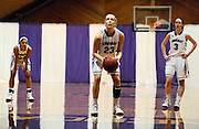 Amherst College's Ali Doswell, center,  lines up a free throw as teammates Hannah Hackley, left, and Jaimie Renner, right, look on during a game against Hamilton College, Friday, Jan. 9, 2015, in Amherst, Mass.  Amherst has broken UConn's women's NCAA record with 104 consecutive home victories and is closing in on the Kentucky men's record of 120-plus wins set decades ago. (Jessica Hill for the New York Times)