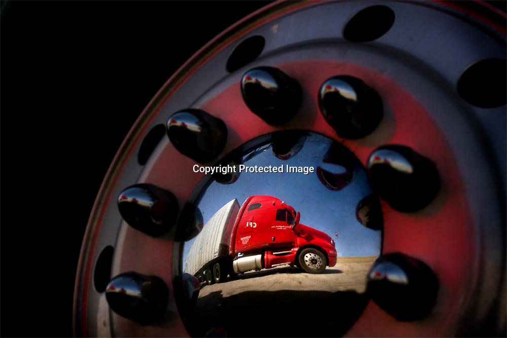 Truck, Kenworth, wheel, tire, CFI, reflection, hubcap, red, silver,.nut, bolt, Wyoming, driving.
