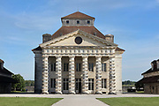 Director's House or Maison du Directeur, part of the Royal Saltworks or Saline Royale, begun 1775 in Neoclassical style by architect Claude Nicolas Ledoux, 1736-1806, at Arc-et-Senans, Doubs, Bourgogne-Franche-Comte, France. The Director's House has an imposing portico with 6 Doric columns, a triangular pediment with oculus and a belvedere. The building houses an assembly room, offices, bank, apartments, servants quarters and a basement for storage. The site is designed in a semicircle, with the Director's House, 2 saltworks containing drying ovens, heating pots and salt stores, workers' accommodation and Director's stables. An Ideal City was also planned but never built. The site is listed as a UNESCO World Heritage site. Picture by Manuel Cohen