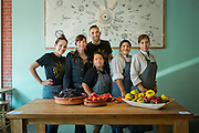 Dominica Rice, owner and chef at Cosecha Cafe in Oakland, California and her kitchen crew take a quick break for a photo while preparing for lunch.