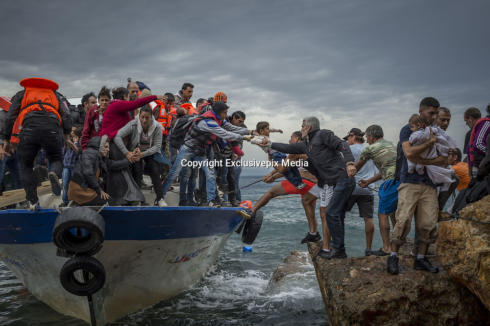 Oct. 11, 2015 - Lesbos Island, Greece - <br /> <br /> Refugees in Lesbos<br /> <br /> Refugees and Migrants aboard fishing boat driven by smugglers reach the coast of the Greek Island of Lesbos after crossing the Aegean sea from Turkey.<br /> ©Exclusivepix Media