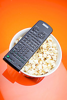 Remote control and bowl with pop corn
