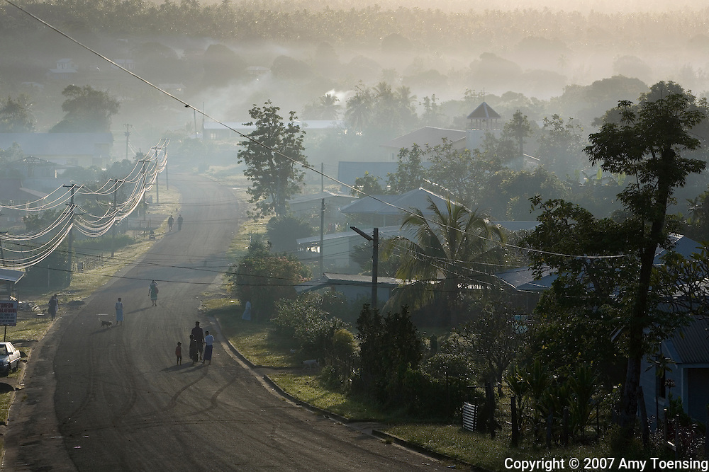 VAVA'U, TONGA - APRIL 26: Morning bustle in the road running through the village of Ta'anea on April 26, 2007 in Vava'u, Tonga. Tonga is one of the last surviving monarchies in the Pacific islands, however there has been a recent push towards democratic reform, challenging the people of Tonga to maintain their cultural heritage while conforming to modern day capitalism. (Photo by Amy Toensing/ Reportage by Getty Images) _________________________________<br />