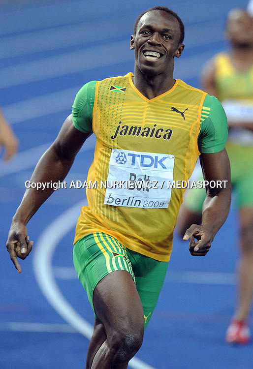 USAIN BOLT (JAMAICA) COMPETES IN 200 METERS MEN ON THE OLYMPIC STADION ( OLIMPIASTADION ) DURING 12TH IAAF WORLD CHAMPIONSHIPS IN ATHLETICS BERLIN 2009.HE TOOK GOLD MEDAL AND BROKE WORLD RECORD..BERLIN , GERMANY , AUGUST 20, 2009..( PHOTO BY ADAM NURKIEWICZ / MEDIASPORT )..PICTURE ALSO AVAIBLE IN RAW OR TIFF FORMAT ON SPECIAL REQUEST.