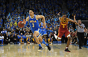 Feb 28, 2019; Los Angeles, CA, USA; UCLA Bruins guard Jules Bernard (3) is pursued by Southern California Trojans guard Shaqquan Aaron (0) in overtime  at Pauley Pavilion. UCLA defeated USC 93-88 in overtime.