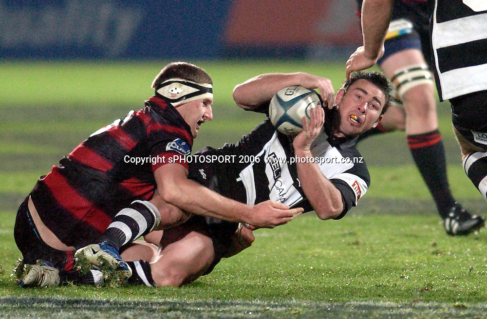 Hawkes Bay's Danny Lee looks to off load as he is tackled during the Air New Zealand Cup week 1 rugby match between Hawke's Bay and Canterbury at Mclean Park, Napier on Friday 28 July 2006. Photo: John Cowpland/PHOTOSPORT<br /> <br /> <br /> <br /> <br /> <br /> 280706