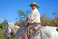 Man on horse near San Luis in Pinar del Rio, Cuba.