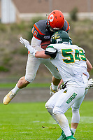 KELOWNA, BC - SEPTEMBER 22:  Conor Richard #10 of Okanagan Sun jumps over Riley Mikkelson #29 and into Lukas Kornelson #54 of Valley Huskers as he tries to tackle him at the Apple Bowl on September 22, 2019 in Kelowna, Canada. (Photo by Marissa Baecker/Shoot the Breeze)