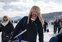 Scott Weaver hailing from Lansing, Michigan hits the ice in his coyote cap ready to play for the 40+ Munny Shot team on Friday during the New England Pond Hockey Classic on Meredith Bay.  (Karen Bobotas/for the Laconia Daily Sun)