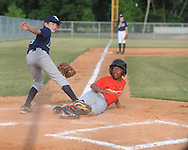 The Cardinals' Jackson Reid is tagged out by Rays' pitcher Ken Presley during Oxford Park Commission baseball action at FNC Park in Oxford, Miss. on Thursday, June 3, 2010.