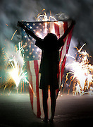 A young girl displays old glory during a July fireworks show in downtown Sacramento.