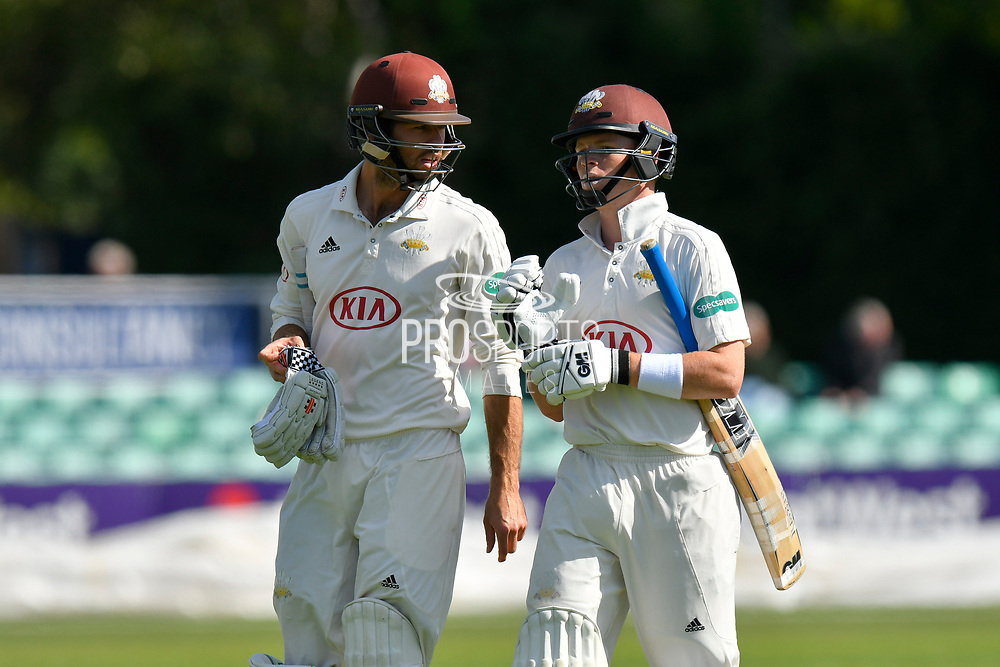 Batsmen Ben Foakes of Surrey and Ollie Pope of Surrey walk off for lunch during the final day of the Specsavers County Champ Div 1 match between Worcestershire County Cricket Club and Surrey County Cricket Club at New Road, Worcester, United Kingdom on 13 September 2018.