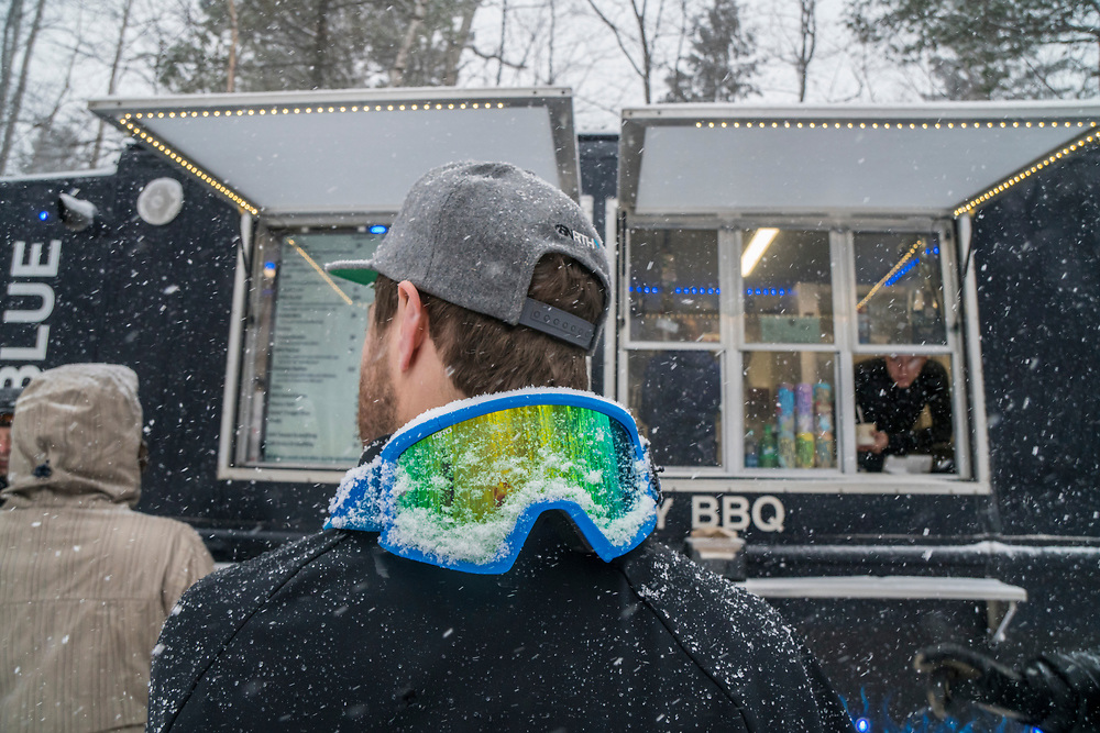 Visiting a bbq food truck while winter fat biking in Marquette, Michigan.