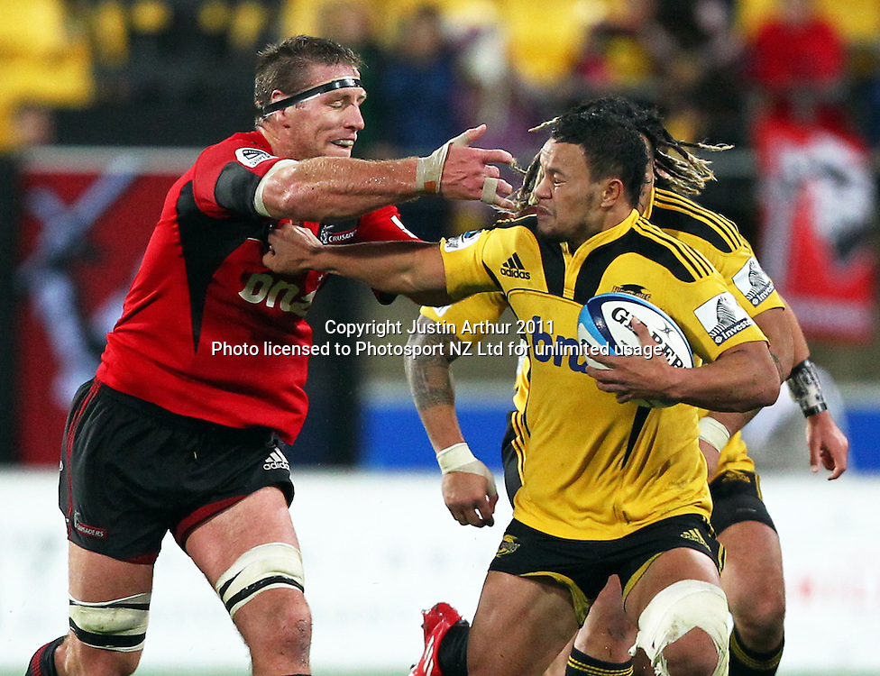Hurricanes Alapati Leiua gets a hand to the face by Brad Thorn .Super15 rugby union match - Crusaders v Hurricanes at Westpac Stadium, Wellington, New Zealand on Saturday, 18 June 2011. Photo: Justin Arthur / photosport.co.nz