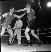 "19/01/1962.01/19/1962.19 January 1962.Irish Amateur National Junior Boxing Championships..""Pardon my glove"", L. O'Shea (right) Clonakilty Boxing Club, seems to say as he lands a straight left to the jaw of T. Gallaghher, Tipperary Boxing Club, during their bout at the 1st Series Light/Middleweight Contest of the Irish Amateur National Junior Boxing Championships held at the National Boxing Stadium, Dublin. O'Shea won on points."
