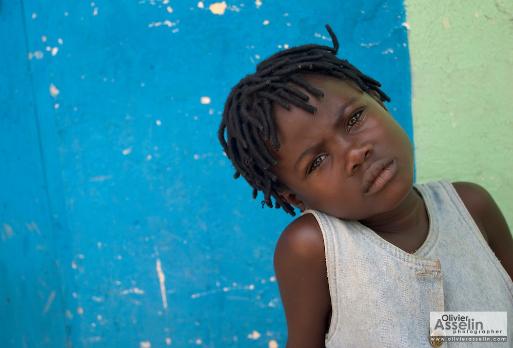 Portrait of young Liberian girl crying.