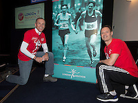 Virgin Money London Marathon 2015<br /> <br /> After todays Press conference Dick Beardsley and Inge Simonsen the winners from the first London Marathon in 1981 35 years ago signed the poster of themselves in the Press Conference Room.<br /> <br /> Left to Right<br /> Dick Beardsley<br /> Inge Simonsen<br /> <br /> Photo: Bob Martin for Virgin Money London Marathon<br /> <br /> This photograph is supplied free to use by London Marathon/Virgin Money.