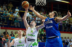 Ziga Dimec of Slovenia vs Amedeo Tessitori of Italy during basketball match between National team of Slovenia and Italy in First Round of U20 Men European Championship Slovenia 2012, on July 12, 2012 in Domzale, Slovenia.  Slovenia defeated Italy 81-68. (Photo by Vid Ponikvar / Sportida.com)
