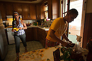 BETHLEHEM, PA – JUNE 28, 2011: Betsy and Wendy Santos of Bethlehem, Pennsylvania clean dishes in preparation for dinner. As a lesbian couple, each share children from previous marriages and represent a growing number of same-sex Hispanic couples in the Lehigh Valley.<br />