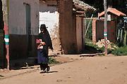 Campesina woman walking in the street in Postrervalle, Santa Cruz, Bolivia