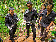 16 JUNE 2015 - CHUAP, NARATHIWAT, THAILAND:  Thai Army Rangers and investigators display a cache of three M16 assault rifles Rangers recovered in a Muslim insurgent camp they captured last week. Thai Rangers, a paramilitary force of the Thai Army, discovered a Muslim insurgent camp in the village of Chuap, in Narathiwat province last week. Most of the insurgents in the camp escaped into the surrounding jungle, but soldiers captured two insurgents and recovered three M16 assault rifles. Two of the three rifles were stolen from the Thai Army in 2004. Investigators are still tracing the source of the third rifle. The Rangers took Thai media into the camp Tuesday. About 6,000 people have been killed in sectarian violence in Thailand's three southern provinces of Narathiwat, Pattani and Yala since a Muslim insurgency started in 2004. Attacks usually spike during religious holidays. Insurgents are fighting for more autonomy from the central government in Bangkok.      PHOTO BY JACK KURTZ