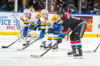 KELOWNA, CANADA - DECEMBER 1:  Nolan Kneen #27 and Max Gerlach #9 of the Saskatoon Blades line up opposite Erik Gardiner #11 of the Kelowna Rockets on December 1, 2018 at Prospera Place in Kelowna, British Columbia, Canada.  (Photo by Marissa Baecker/Shoot the Breeze)