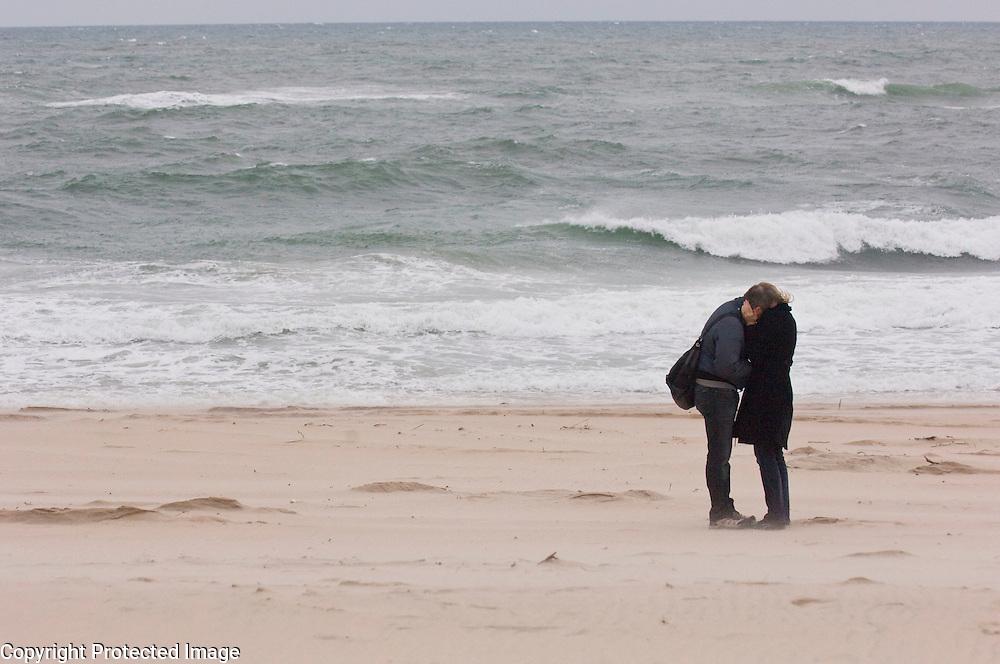 Victor Henken, left, and Mimi Henken, from Manhattan, watch the water at Main Beach in East Hampton, NY, Saturday, May 3, 2008.    Photographer:  GORDON M. GRANT/Bloomberg News