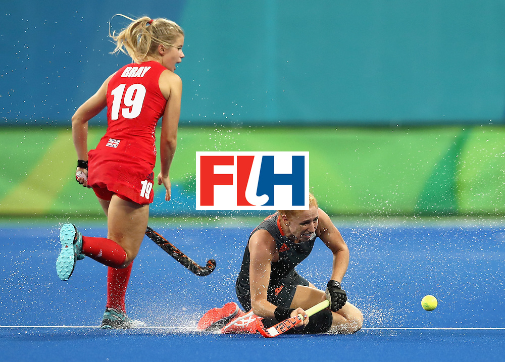 RIO DE JANEIRO, BRAZIL - AUGUST 19:  Sophie Bray of Great Britain and Margot van Geffen of Netherlands in action on Day 14 of the Rio 2016 Olympic Games at the Olympic Hockey Centre on August 19, 2016 in Rio de Janeiro, Brazil.  (Photo by David Rogers/Getty Images)