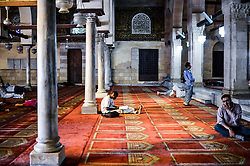 60103057 <br /> An Egyptian Muslim reads Quran waiting for the time to break their fast at Al-Azhar Mosque on the first day of the holy month of Ramadan in Cairo, Egypt on Wednesday, July 10, 2013.<br /> Photo by imago / i-Images