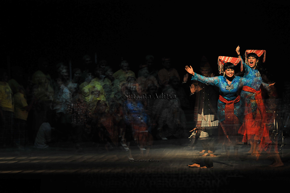 The theatre exhibition of Sumatran dance in Indonesia. Picture taken by multiple exposure on three frame on November 07, 2012.