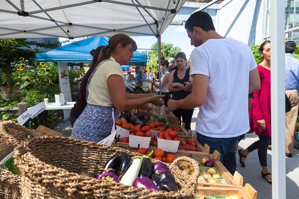 Farmers and shoppers at Wychwood Barns Farmers Market in Toronto.