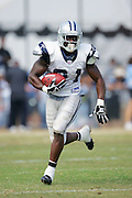 OXNARD, CA - AUGUST 17:  Running back Julius Jones #21 of the Dallas Cowboys runs the ball during Dallas Cowboys training camp on August 17, 2006 in Oxnard, California. ©Paul Anthony Spinelli *** Local Caption *** Julius Jones