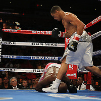 """Light Heavyweight and WBC ranked #3 Humberto """"El Don"""" Savigne (right) knocks down Jeff Lacy during the """"Judgement Day"""" boxing event at American Airlines Arena on Thursday, July 10, 2014 in Miami, Florida.  (AP Photo/Alex Menendez)"""