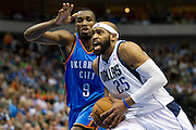 Vince Carter (25) of the Dallas Mavericks drives past Serge Ibaka (9) of the Oklahoma City Thunder at the American Airlines Center in Dallas on Sunday, March 17, 2013. (Cooper Neill/The Dallas Morning News)