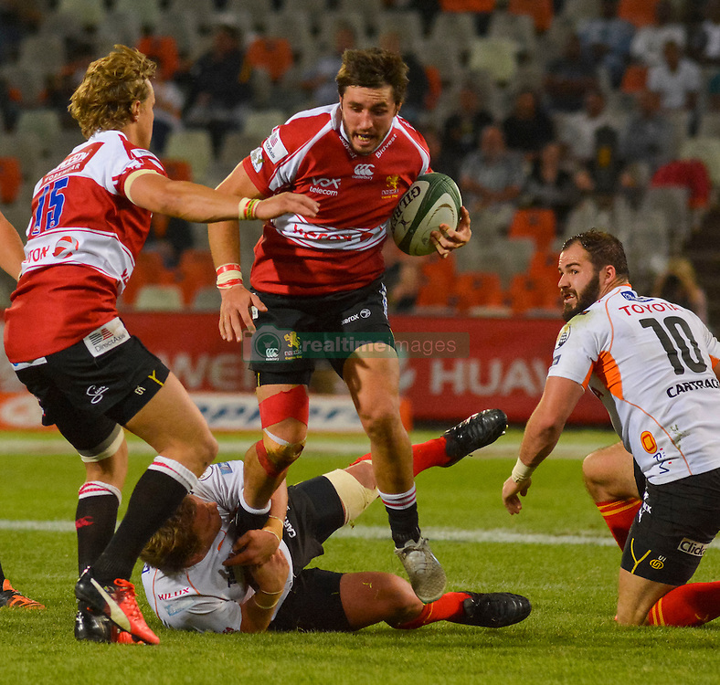 Jacques Nel of the Lions and Torsten van Jaarsveld(C) of the Free State Cheetahs hanging on to the tackle during the Currie Cup Premier division match between the The Free State Cheetahs and the Lions held at Toyota Stadium (Free State Stadium), Bloemfontein, South Africa on the 15th September 2016<br /> <br /> Photo by:   Frikkie Kapp / Real Time Images