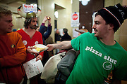 Elliot Flax of Ian's Pizza distributes pizzas donated to protestors at the State Capitol in Madison, WI, February 23, 2011.