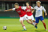 ALKMAAR - AZ - Aalesunds, voetbal,  seizoen 2011-2012, 25-08-2011, Europa League, AFAS Stadion, AZ speler Pontus Wernbloom (l), Aalesunds speler Fredrik Carlsen (r).