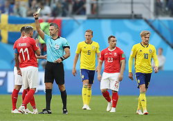 SAINT PETERSBURG, July 3, 2018  The referee gives a yellow card to Valon Behrami (2nd L) of Switzerland during the 2018 FIFA World Cup round of 16 match between Switzerland and Sweden in Saint Petersburg, Russia, July 3, 2018. Sweden won 1-0 and advanced to the quarter-final. (Credit Image: © Cao Can/Xinhua via ZUMA Wire)