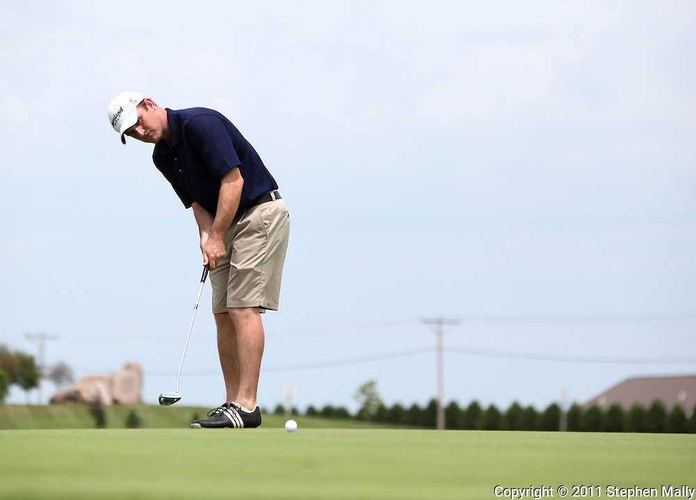 Brian Brodell of Verona, Wisconsin putts the ball on the tenth hole during the second round of the Greater Cedar Rapids Open held at Hunters Ridge Golf Course in Marion on Saturday, July 23, 2011.