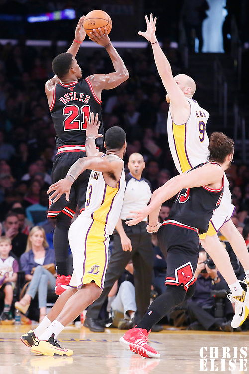 09 February 2014: Chicago Bulls shooting guard Jimmy Butler (21) takes a jumpshot over Los Angeles Lakers center Chris Kaman (9) during the Chicago Bulls 92-86 victory over the Los Angeles Lakers at the Staples Center, Los Angeles, California, USA.
