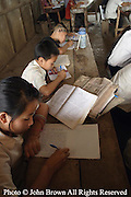 Students concentrate on their lessons at The Ban Buamlao Primary School in Ban Buamlao, Laos.