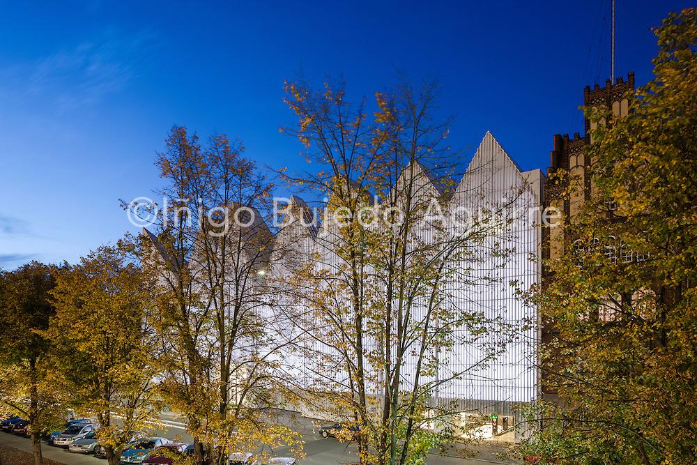 Elevated view with autumn trees obscuring facade. Szczecin Philharmonic Hall, Szczecin, Poland. Architect: Estudio Barozzi Veiga, 2014.