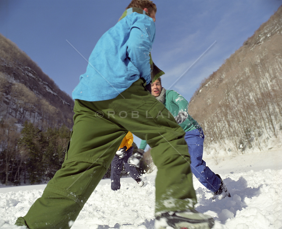 man enjoying time together playing in snow on a mountain in Upstate New York