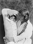 Native American Indian Achomawi mother and child, 1923. Photograph by Edward Curtis (1868-1952).