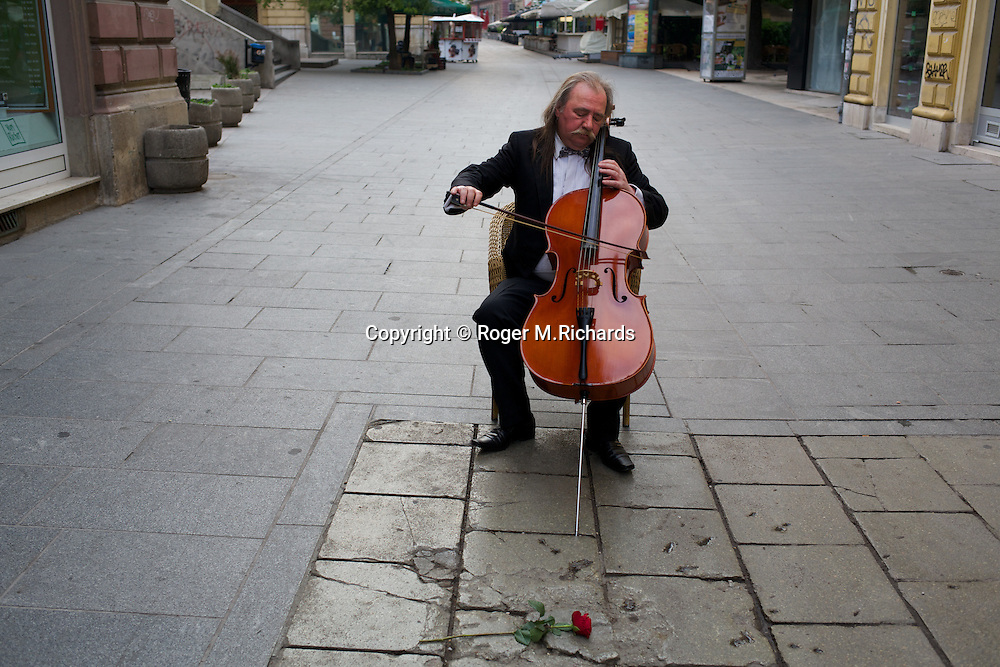 Former Sarajevo Symphony cellist Vedran Smajlovic plays Tommaso Albinoni's 'Adagio' in memory of 27 people killed by mortar shells while they were lined up for bread during the Serb siege of the city, Sarajevo, Bosnia and Herzegovina.