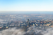 Nederland, Flevoland, Almere, 11-12-2013; Stadshart van Almere in de mist, de hoogbouw rond het station steekt net boven de wolken uit. IJsselmeer in de achtergrond.<br /> Heart of the newly constructed city of Almere in the fog.<br /> luchtfoto (toeslag op standaard tarieven);<br /> aerial photo (additional fee required);<br /> copyright foto/photo Siebe Swart.