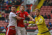Coventry City defender Aaron Martin and Sheffield United defender, on loan from Birmingham City, David Edgar  watched by Sheffield United goalkeeper George Long  during the Sky Bet League 1 match between Sheffield Utd and Coventry City at Bramall Lane, Sheffield, England on 13 December 2015. Photo by Simon Davies.